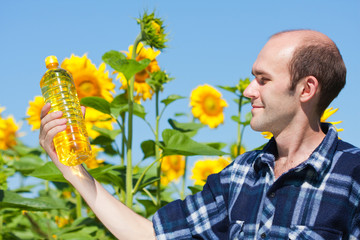 Farmer holding bottle of sunflowers oil