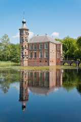 An ancient Dutch castle reflected in the pond.