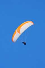 paraglider on blue sky