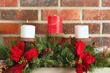 Christmas mantel decor - candles, evergreens, and poinsettia