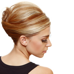 face blond woman with long eyelashes.