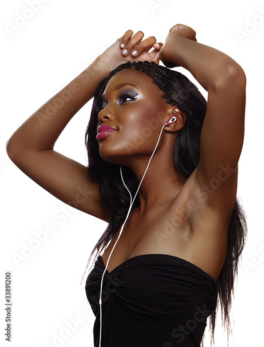 African woman dancing to music