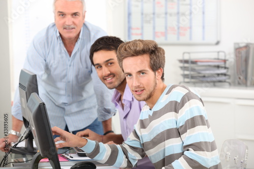 Young men working at their computers