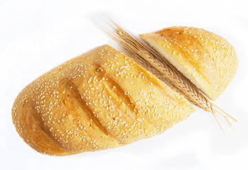 long loaf of bread and wheat ears