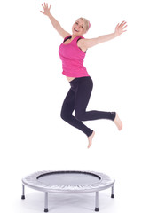 jumping young woman on the trampoline