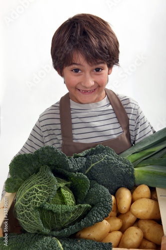 kid in front of vegetables
