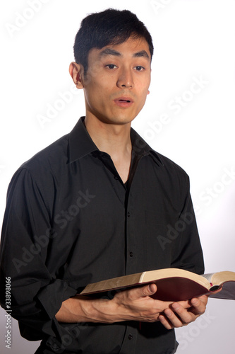 A pious Asian man praying