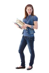 Young girl with books smiling