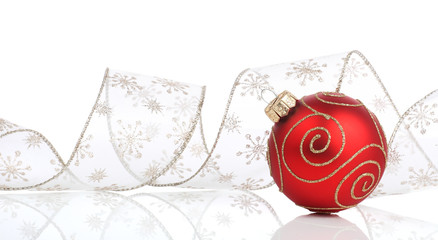 Red christmas bauble with ribbon