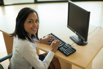 Cute Working Asian Woman Computer