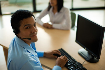 Hispanic Male Customer Service Representative Headset