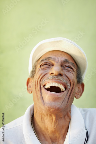 aged latino man smiling for joy