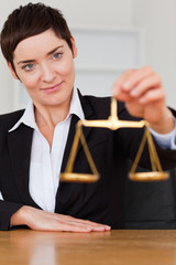Woman holding the justice scale
