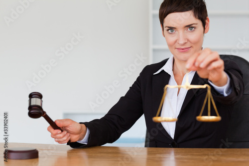 Judge with a gavel and the justice scale
