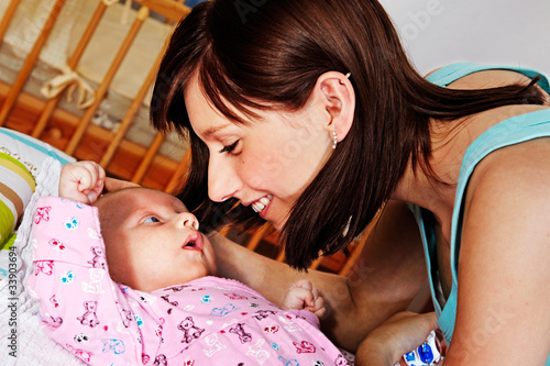 young mother with 7 week old baby