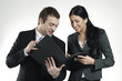 businessman and businesswoman looking at portfolio
