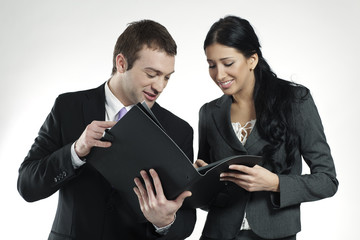 businessman and businesswoman looking at portfolio