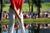 Fototapety Man playing golf
