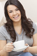 Beautiful Hispanic Latina Woman Drinking Tea or Coffee