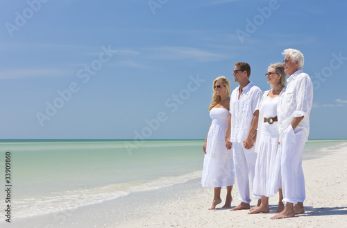 Two Couples Family Generations Holding Hands on Tropical Beach