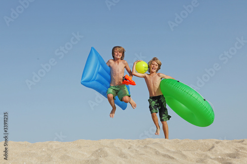 Kids on beach holiday summer vacation