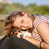 happy teen young woman with her pet puppy dog