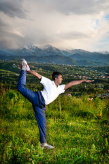 Yoga natarajasana dancer pose in mountains
