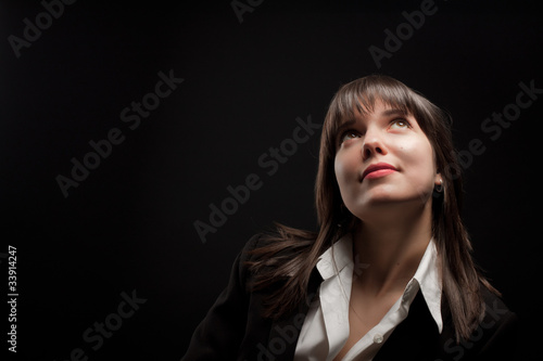 Portrait of brunette girl on dark background