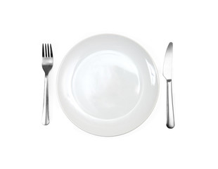 Close up of a diner plate with fork and spoon