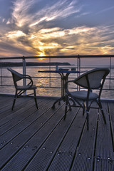 Chairs in restaurant during the sunset