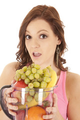 woman fruit blender surprised