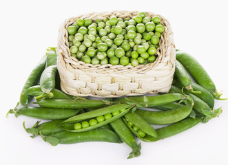 wood basket with green peas the isolated