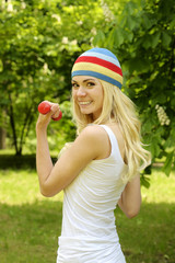 Sporty woman is working out outdoor.
