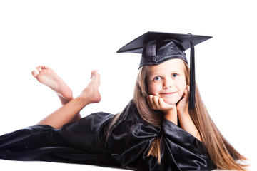 Cute little girl in graduation dress on isolated white