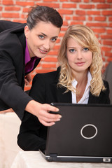 Businesswomen on laptop