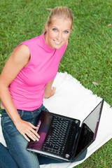 young attractive woman works on her laptop