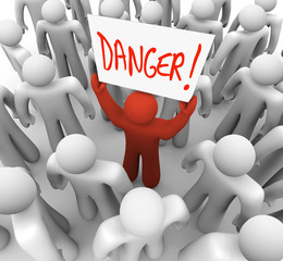 Danger - Person Holding Sign to Warn or Alert Others