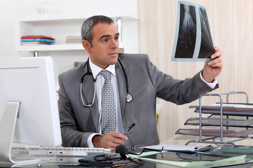 Doctor examining x-ray of hand