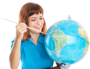 Red-haired girl is painting globe