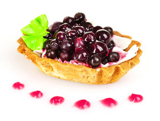 tasty cake with cream and blueberries isolated on white
