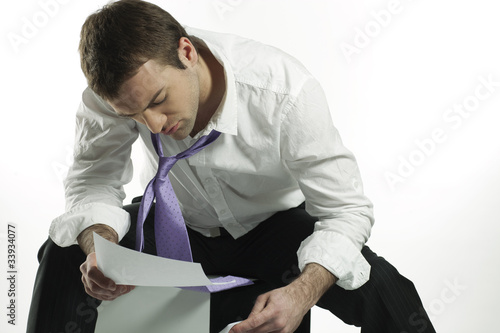 businessman looking at bad business news