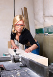 beautiful girl working in the carpentry shop poster