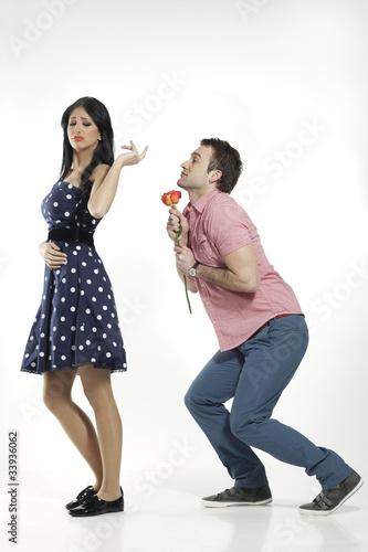 pretty woman refusing apologies from pleading boyfriend