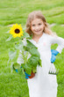 Little gardener with sunflower