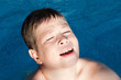 Sunny little boy swiming
