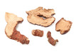 Dried slices of galangal on white background