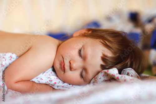bright portrait of adorable sleeping baby