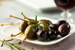Marinated olives and caper berries