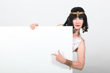 Cleopatra pointing at sign