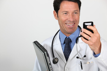 Doctor with a cellphone and laptop computer